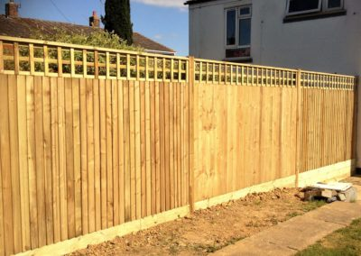 Close board fences are sturdy and long lasting. Here it has been enhanced with a lattice fence topper, to to create an elegant consistency throughout the garden.